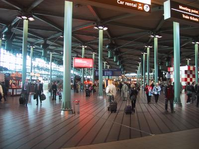 Schipol Airport is modern, well laid out and full of shops. The trains to Amsterdam are just around the corner and down the stairs.