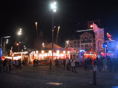 Dam square was occupied by a carnival midway with bungee and spinning rides. Lots of people and lights.