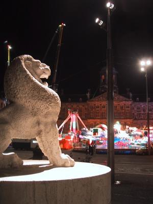 Across Damstraat from the carnival was the National monument and the Lion statue. Very impressive at night.