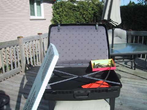 Delsey suitcase, styrofoam, track and sunshine